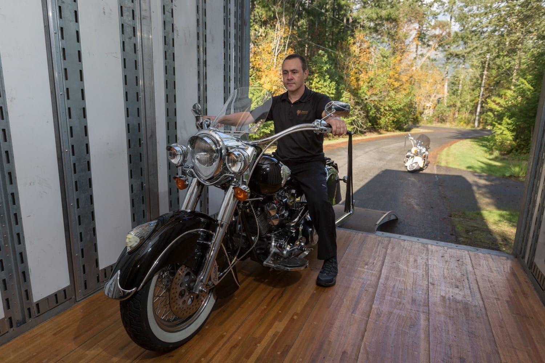 Adam Breton setting bike onto trailer